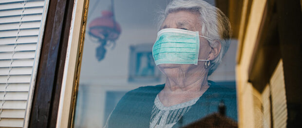 Retired woman wearing a mask