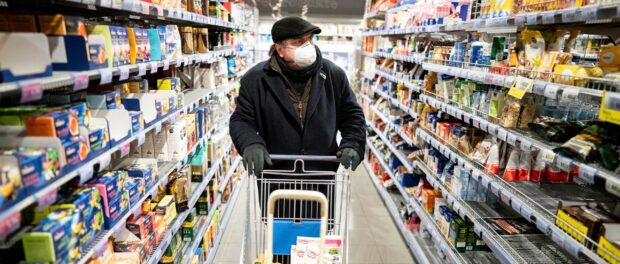 masked shopper at the shop