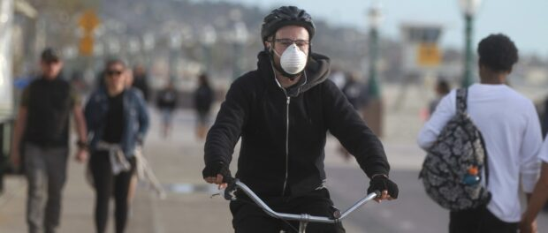 Bicyclist wearing a mask